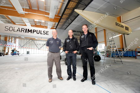 Swiss Pilot and Astronaut Claude Nicollier Left Solar Impulse Co-founder and Chairman Bertrand Piccard Center and Solar Impulse Co-founder and Ceo Andre Borschberg Right Pose After a News Conference About the First Night Flight of the Solar Impulse Hb-sia at the Solar Impulse Base Aeroplane Hangar in Payerne Switzerland 10 June 2010 Switzerland Schweiz Suisse Payerne