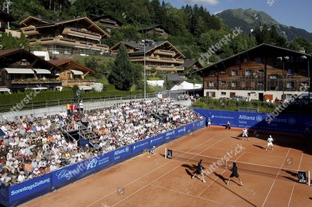 Stanislas Wawrinka and Stephane Bohli From Switzerland Back Play Against Jean-claude Scherrer From Switzerland and Philipp Oswald From Austria on Court One During the Suisse Open Tennis Tournament in Gstaad Switzerland 10 July 2008 Switzerland Schweiz Suisse Gstaad
