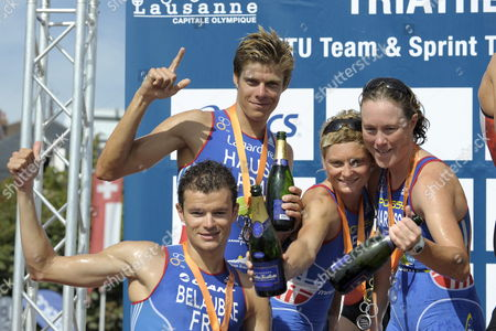 Members of the Second Placed Team France with From L-r Frederic Belaubre David Hauss Carole Peon and Jessica Harrison Celebrate Their Silver Medal After the Itu Team Triathlon World Championships in Lausanne Switzerland 22 August 2010 Switzerland Schweiz Suisse Lausanne