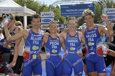 Members of the Second Placed Team France with Frederic Belaubre Carole Peon Jessica Harrison and David Hauss From Left Celebrate As They Crossed the Finish Line During the Itu Team Triathlon World Championships in Lausanne Switzerland Sunday August 22 2010 Switzerland Schweiz Suisse Lausanne