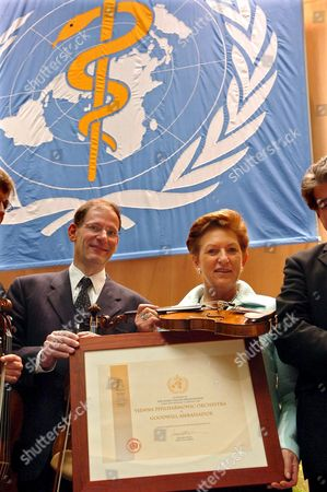 Austrian Clemens Hellsberg Right Chairman of the Vienna Philharmonic Orchestra and Austrian Health Minister Maria Rauch-kallat Right During a Photo Opportunity For the Appointment of the Vienna Philharmonic Orchestra As who Goodwill Ambassador After the First Plenary Meeting of the 58th World Health Assembly at the United Nations in Geneva Switzerland Monday May 16 2005 the Fifty-eighth World Health Assembly Will Takes Place From 16 to May 25 Bringing Together Delegates From Who's 192 Member States to Discuss Key Public Health Issues (keystone/laurent Gillieron) Switzerland Schweiz Suisse Geneva