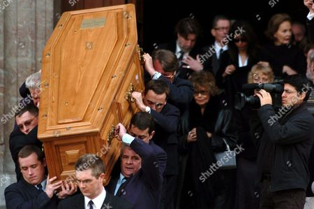 Pall Bearers Carry the Coffin of Late Oscar-winning British Actor and Playwright Sir Peter Ustinov at the Cathedral St Pierre in Geneva Switzerland Saturday 03 April 2004 Ustinov's Wife Helen (c) Follows the Coffin Author of More Than a Dozen Books and Even More Theatrical Works in a Career Spanning More Than 60 Years Ustinov Died of Heart Failure in a Clinic Near His Home on the Shores of Lake Geneva on Sunday March 28 2004 at the Age of 82 Switzerland Schweiz Suisse Geneva