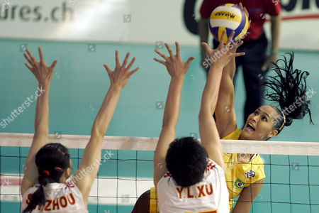 Brazilian Jaqueline Carvalho Back Plays a Ball Against Chinese Suhong Zhou and Yunil Xu Front During the Final Game Between Brazil and China at the Montreux Volley Masters Tournament in Montreux Switzerland Sunday 11 June 2006 Brazilian Team Won the Final Switzerland Schweiz Suisse Monthey