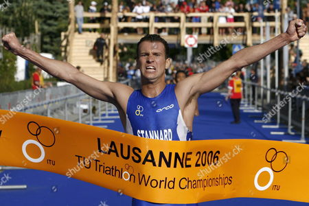 Britain's Richard Stannard Celebrates As He Crosses the Finish Line to Win the Men's Itu Aquathlon World Championships in Lausanne Switzerland Wednesday August 30 2006 the Sport of Aquathlon Consists of a Continuous Two-stage Race Involving Swimming Followed by Running Switzerland Schweiz Suisse Lausanne