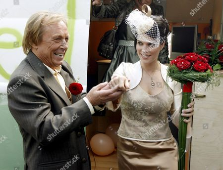 German Actor Claus Theo Gaertner Known As Detective 'Matula' From the Tv Production 'Ein Fall Fuer Zwei' (a Case For Two) Helps His Newly Wed Wife Swiss Sarah Wuergler out of a Vw Camping Bus 20 September 2008 in Winterthur Switzerland Switzerland Schweiz Suisse Winterhur
