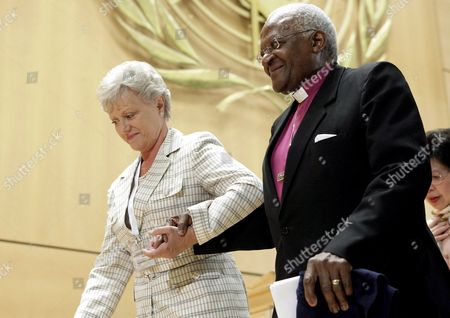 Princess Muna Al Hussein of Jordan (l) and South Africa's Desmond Tutu (r) Archbishop and Nobel Peace Prize Laureate Leave the Podium After Their Speech During the 61st World Health Organization (who) Annual Assembly at the European Headquarters of the United Nations in Geneva Switzerland 20 May 2008 Switzerland Schweiz Suisse Genf Geneve Geneva Ginevra