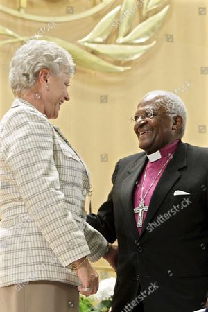 Princess Muna Al Hussein of Jordan (l) and South Africa's Desmond Tutu (r) Archbishop and Nobel Peace Prize Laureate Smile on the Podium After Their Speeches During the 61st World Health Organization (who) Annual Assembly at the European Headquarters of the United Nations in Geneva Switzerland 20 May 2008 Switzerland Schweiz Suisse Genf Geneve Geneva Ginevra