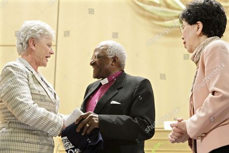 Princess Muna Al Hussein of Jordan (l) Shakes Hands with South Africa's Desmond Tutu (c) Archbishop and Nobel Peace Prize Laureate Next to China's Margaret Chan Director General of the World Health Organization who After Their Speeches During the 61st World Health Organization (who) Annual Assembly at the European Headquarters of the United Nations in Geneva Switzerland 20 May 2008 Switzerland Schweiz Suisse Genf Geneve Geneva Ginevra