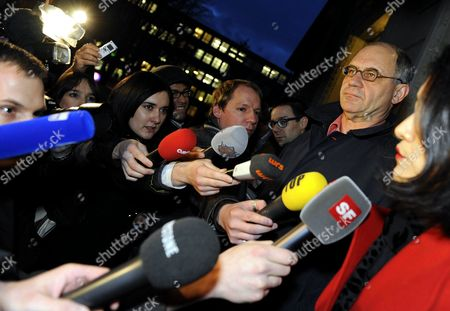 Stock Picture of Swiss Rudolf Elmer (r) Whistle-blower and Former Top-banker at the Bank Julius Baer Answers Journaist's Question in Front of the Zurich District Court in Zurich Switzerland 19 January 2011 on 17 January 2011 Elmer Handed Over Two Cds to Wikileaks Founder Julian Assange in Front of the Worlds Media Switzerland Schweiz Suisse Zurich