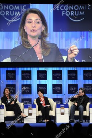 (l-r) Melinda French Gates Also on Screen Co-chair of the Bill & Melinda Gates Foundation China's Margaret Chan Director General of the World Health Organization who and Irish U2 Band Lead Singer Bono Co-founder of One Campaign Attend a Panel Session at the 41st Annual Meeting of the World Economic Forum Wef in Davos Switzerland on 28 January 2011 the Overarching Theme of This Year's World Economic Forum Annual Meeting From 26 to 30 January is 'Shared Norms For the New Reality' Switzerland Schweiz Suisse Davos