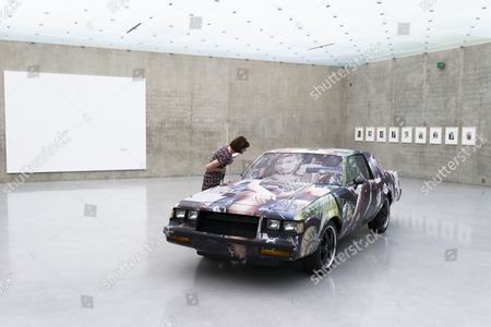 A Visitor Looks at the Artwork 'Untitled' 2008 with the Works 'Untitled (piano Joke)' 2013 on the Left and 'Untitled' 2011 on the Right Side by Us Artist Richard Prince at the 'Kunsthaus Bregenz' 17 July 2014 in Bregenz Austria the Museum Shows Prince's Exhibtion 'It's a Free Concert' From 19 July to 05 October Austria Bregenz