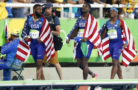 (l-r) Tyson Gay Justin Gatlin and Mike Rodgers React After the Men's 4x100m Relay Final of the Rio 2016 Olympic Games Athletics Track and Field Events at the Olympic Stadium in Rio De Janeiro Brazil 19 August 2016 Brazil Rio De Janeiro