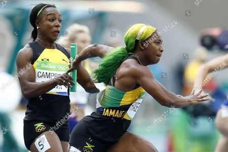 Veronica Campbell-brown (l) of Jamaica Passes the Baton to Shelly-ann Fraser-pryce (r) During the Women's 4x100m Relay Heats of the Rio 2016 Olympic Games Athletics Track and Field Events at the Olympic Stadium in Rio De Janeiro Brazil 18 August 2016 Brazil Rio De Janeiro