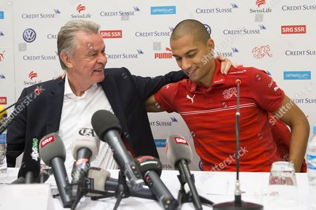 Swiss National Soccer Team's German Head Coach Ottmar Hitzfeld (l) and Captain Gokhan Inler (r) Attend a Press Conference in Sao Paulo Brazil 02 July 2014 Switzerland Failed to Reach the Fifa World Cup 2014 Quarter Finals After Being Defeated 1-0 by Argentina in Their Round of 16 Match at the Arena Corinthians in Sao Paulo on 01 July 2014 Brazil Sao Paulo