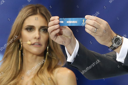 Fifa Secretary General Jerome Valcke Holds the Lot of Honduras Next to Host Fernanda Lima During the Final Draw of the Preliminary Round Groups of the 2014 Fifa World Cup Brazil in Costa Do Sauipe Brazil 06 December 2013 Brazil Costa Do Sauipe