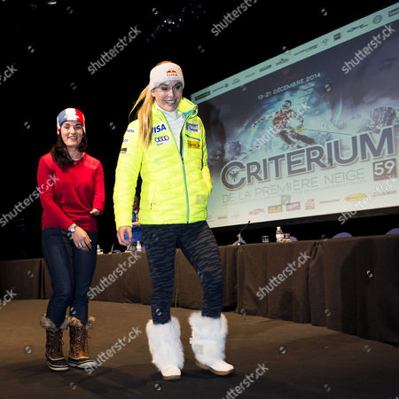 Lindsey Vonn (r) of the Usa and French Paralympic Champion Marie Bochet (l) Attend a Press Conference Prior to the Alpine Skiing World Cup Races in Val D'isere France 18 December 2014 the Women's Alpine Skiing World Cup Races in Val D'isere Will Take Place From 19 to 21 December 2014 France Val D'isere