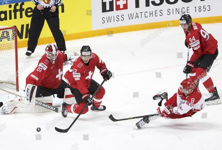 Denmark's Frederik Storm (2-r) Vies For the Puck with Swiss Players Felicien Du Bois (2-l) Samuel Walser (r) and Goalkeeper Reto Berra (l) During the Iihf 2016 World Championship Preliminary Round Game Between Switzerland and Denmark at the Ice Palace in Moscow Russia 10 May 2016 Russian Federation Moscow