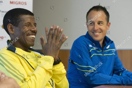 Ethiopian Long-distance Track Athlete Haile Gebrselassie (l) Speaks Next to Swiss Long-distance Runner Victor Roethlin (r) During a Media Conference in Bern Switzerland 16 May 2013 the Grand Prix Bern Public Run in Which Gebrselassie Will Also Participate Will Take Place on 18 May 2013 Switzerland Schweiz Suisse Bern