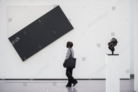 A Visitor Looks on the Artwork 'White Triangle with Black' by Us Artist Ellsworth Kelly During an Exhibition Organized by Swiss Art Collector Hubert Looser (unseen) at the Kunsthaus in Zurich Switzerland 06 June 2013 the Hubert Looser Collection Exhibition Runs From 07 June to 08 September Switzerland Schweiz Suisse Zurich