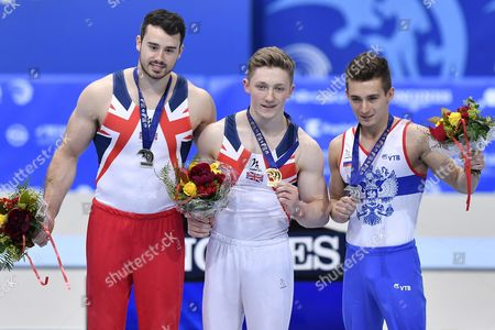 Nile Wilson (c) From Great Britain As the Winner Kristian Thomas (l) From Great Britain As Second and David Belyavskiy From Russia As Third Celebrate on the Podium of the Horizontal Bar During the Men's Apparatus Finals at the European Men's and Women's Artistic Gymnastics Championships at the Postfinance Arena in Bern Switzerland 29 May 2016 Switzerland Schweiz Suisse Bern