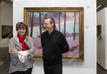 Micheline Calmy-rey (l) Former Swiss Federal Councillor and Daniel Salzmann (r) President of the Pierre Arnaud Foundation Smile in Front of the Drawing 'Le Vent D'aquilon' 1902-1904 by Carlo Fornara (1871-1968) on the Occasion of the Exhibition 'Divisionism: Mastery of Colour? Effusion of Colour!' During the Inauguration of the New Art Centre of the Pierre Arnaud Foundation in Lens Near Crans-montana Switzerland 19 December 2013 Switzerland Schweiz Suisse Lens