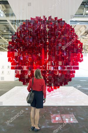 The Art Installation 'Continuel Mobile - Sphere Rouge' (2001-2013) by Argentine Artist Julio Le Parc Represented by the Gallery Bugada and Cargnel (paris) is on Display During the Exhibition 'Unlimited' As Part of the International Art Show Art Basel in Basel Switzerland 16 June 2014 'Unlimited' is Art Basel's Exhibition Platform For Projects That Transcend the Limitations of a Classical Art-show Stand Including Out-sized Sculpture and Paintings Video Projections Large-scale Installations and Live Performances the Event is Curated by New York-based Swiss Curator Gianni Jetzer Switzerland Schweiz Suisse Basel