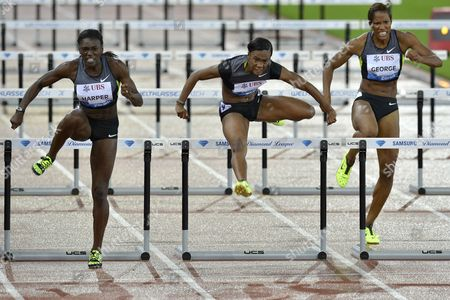 Dawn Harper From the Usa (l) Leads Fellow Countrywoman Kellie Wells (c) and Phylicia George From Canada Over the Hurdles on Her Way Winning the Womens 100m Hurdles Race During the Weltklasse Iaaf Diamond League International Athletics Meeting in the Letzigrund Stadium in Zurich Switzerland on Thursday August 30 2012 Wells Placed Third and George 8th Switzerland Schweiz Suisse Zurich