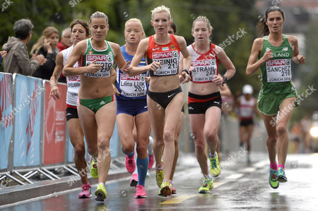 From Left: Ursula Spielmann-jeitziner From Switzerland Doroteia Peixoto From Portugal Liina Luik From Estonia Katharina Heinig From Germany Martina Straehl From Switzerland and Barbara Sanchez From Irland Compete in the Women's Marathon in the City Centre of Zurich at the Fifth Day of the European Athletics Championships in Zurich Switzerland Saturday August 16 2014 Switzerland Schweiz Suisse Zurich