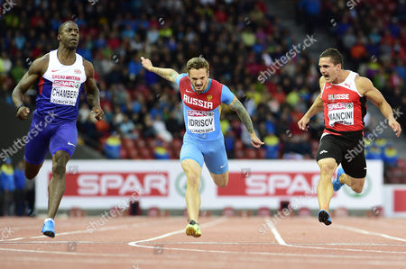 Pascal Mancini From Switzerland Right Competes Next to Mikhail Idrisov From Russia Centre and Dwain Chambers From Great Britain Left in the Men's 100m Semifinal at the Second Day of the European Athletics Championships in the Letzigrund Stadium in Zurich Switzerland 13 August 2014 Switzerland Schweiz Suisse Zurich