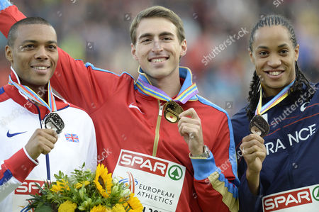 Men's 110m Hurdles Race Winner Sergey Shubenkov (c) From Russia Second Placed William Sharman (l) From Great Britain and Third Placed Pascal Martinot-lagarde (r) From France Pose with Their Medals at the Medal Ceremony During the European Athletics Championships in the Letzigrund Stadium in Zurich Switzerland 15 August 2014 Switzerland Schweiz Suisse Zurich