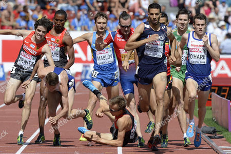 Mahiedine Mekhissi-benabbad (2nd R) From France Timo Benitz (l) From Germany and Chris O'hare Compete While Charlie Grice (2nd L) From Britain and Florian Orth (3rd L) From Germany Fall in the Men's 1'500m Final During the European Athletics Championships in the Letzigrund Stadium in Zurich Switzerland 17 August 2014 Switzerland Schweiz Suisse Zurich
