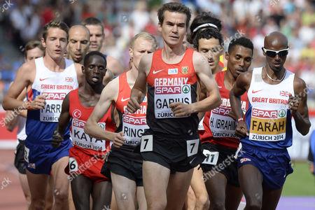 Mohamed 'Mo' Farah (r) From Great Britain Competes Next to Arne Gabius (l) From Germany in the Men's 5'000m Final During the European Athletics Championships in the Letzigrund Stadium in Zurich Switzerland 17 August 2014 Switzerland Schweiz Suisse Zurich
