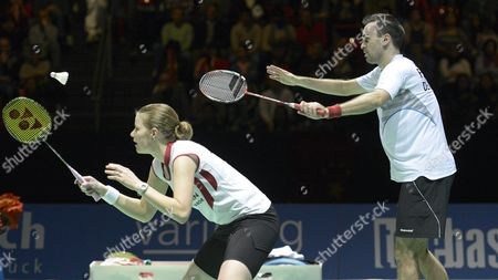 Denmark's Joachim Fischer Nielsen (r) and Christinna Pedersen (l) Serve a Shuttlecock to China's Nan Zhang and Jinhua Tang During Their Mixed Doubles Final Match at the Badminton Swiss Open Tournament at the St Jakobshalle in Basel Switzerland 17 March 2013 Switzerland Schweiz Suisse Basel
