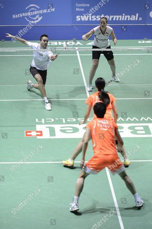 Denmark's Joachim Fischer Nielsen (back L) and Christinna Pedersen (back R) Return a Shuttlecock to China's Nan Zhang and Jinhua Tang During Their Mixed Doubles Final Match at the Badminton Swiss Open Tournament at the St Jakobshalle in Basel Switzerland 17 March 2013 Switzerland Schweiz Suisse Basel