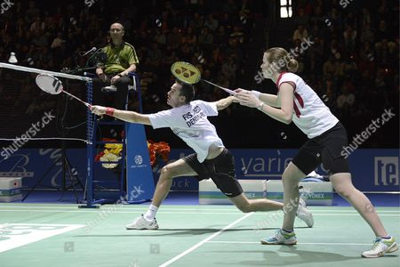 Denmark's Joachim Fischer Nielsen (l) and Christinna Pedersen (r) Return a Shuttlecock to China's Nan Zhang and Jinhua Tang During Their Mixed Doubles Final Match at the Badminton Swiss Open Tournament at the St Jakobshalle in Basel Switzerland 17 March 2013 Switzerland Schweiz Suisse Basel