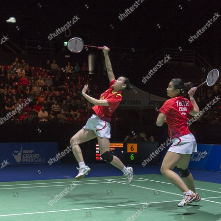 China's Yixin Bao (l) and Jinhua Tang (r) Return a Shuttlecock to Indonesia's Nitya Krishinda Maheswari and Greysia Polii During Their Women's Doubles Final Match at the Badminton Swiss Open Tournament in the St Jakobshalle in Basel Switzerland 16 March 2014 Switzerland Schweiz Suisse Basel