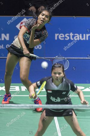 Indonesia's Nitya Krishinda Maheswari (back) and Greysia Polii Return a Shuttlecock to China's Yixin Bao and Jinhua Tang During Their Women's Doubles Final Match at the Badminton Swiss Open Tournament in the St Jakobshalle in Basel Switzerland 16 March 2014 Switzerland Schweiz Suisse Basel