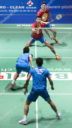 China's Biao Chai and Wei Hong in Action Against Haifeng Fu and Nan Zhang (from Back to Front) During Their Men's Doubles Final Match at the Badminton Swiss Open Tournament in the St Jakobshalle in Basel Switzerland 16 March 2014 Switzerland Schweiz Suisse Basel