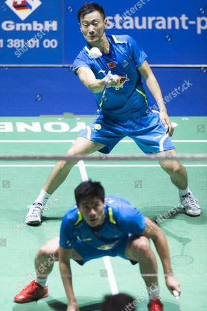 China's Haifeng Fu (front) and Nan Zhang in Action Against Compatriots Biao Chai and Wei Hong During Their Men's Doubles Final Match at the Badminton Swiss Open Tournament in the St Jakobshalle in Basel Switzerland 16 March 2014 Switzerland Schweiz Suisse Basel
