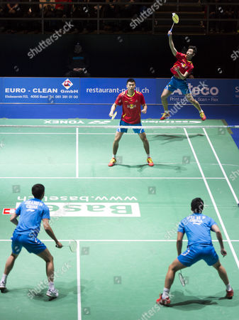China's Wei Hong Back Left and Biao Chai Back Right in Action Against Compatriots Nan Zhang Front Left and Haifeng Fu Front Right During Their Men's Doubles Final Match at the Badminton Swiss Open Tournament in the St Jakobshalle in Basel Switzerland 16 March 2014 Switzerland Schweiz Suisse Basel