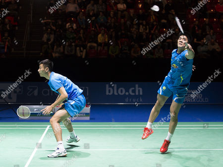 China's Haifeng Fu (r) and Nan Zhang in Action Against Compatriots Biao Chai and Wei Hong During Their Men's Doubles Final Match at the Badminton Swiss Open Tournament in the St Jakobshalle in Basel Switzerland 16 March 2014 Switzerland Schweiz Suisse Basel