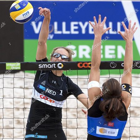 Stock Picture of Sophie Van Gestel (l) of the Netherlands in Action Against Italy's Viktoria Orsi Toth (r) During Their Women's Preliminary Round Match of the 2016 Cev Beach Volleyball European Championships at the Nicolas G Hayek Park in Biel Switzerland 02 June 2016 Switzerland Schweiz Suisse Biel