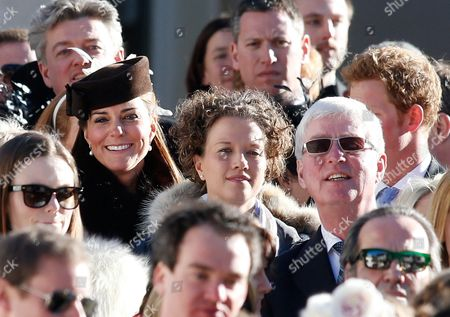 British Prince Harry (r Slightly Hidden) and Catherine Duchess of Cambridge (c-l) Leave the Evangelical Church in Arosa 02 March 2013 Prince William His Wife Catherine Duchess of Cambridge Along with Prince Harry Are Attending the Wedding of Their Friends Swiss-british Dressage Rider Laura Bechtolsheimer and Polo Player Mark Tomlinson Switzerland Schweiz Suisse Arosa