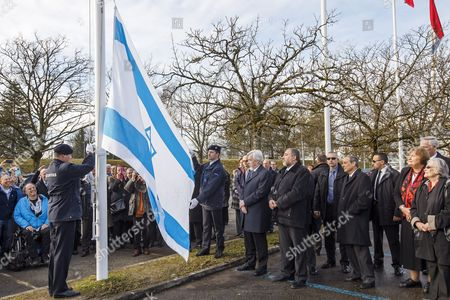 Hounour Guards Raise Israel's Flag As Rolf-dieter Heuer (l) Director-general of Cern (the European Organization For Nuclear Research) and Avigdor Liberman (2-l) Deputy Prime Minister and Minister of Foreign Affairs of Israel Look on During the Ceremony to Welcome Israel As Its 21st Member State of Cern at the European Particle Physics Laboratory (cern) in Meyrin Near Geneva Switzerland 15 January 2014 Switzerland Schweiz Suisse Meyrin