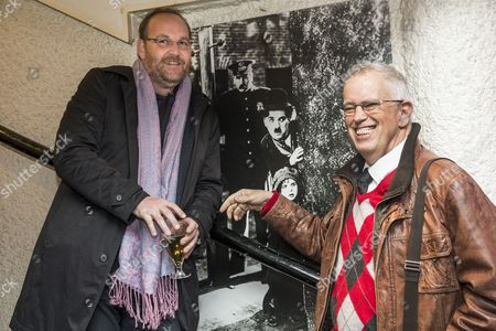 French Director Xavier Beauvois (l) and Swiss Filmmaker Eugene Chaplin Son of Charlie Chaplin Pose For Photographers As They Arrive For the Swiss Screening of the Movie 'La Rancon De La Gloire' at the Cinema Rex in Vevey Switzerland 10 December 2014 Switzerland Schweiz Suisse Vevey