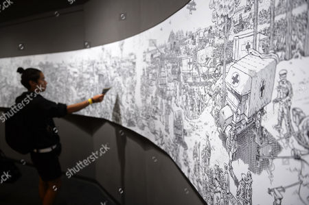 A Visitor Looks at the More Than 30 Meters Long Panoramic Work 'La Grande Guerre' by Maltese-american Cartoonist Joe Sacco During the Lausanne Comic Festival in Lausanne Switzerland 11 September 2014 the Event Runs From 11 to 14 September Switzerland Schweiz Suisse Lausanne