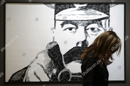 Stock Image of A Visitor Stands in Front of a Work by Maltese-american Cartoonist Joe Sacco During the Lausanne Comic Festival in Lausanne Switzerland 11 September 2014 the Event Runs From 11 to 14 September Switzerland Schweiz Suisse Lausanne