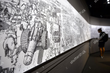 Stock Photo of A Visitor Looks at the More Than 30 Meters Long Panoramic Work 'La Grande Guerre' by Maltese-american Cartoonist Joe Sacco During the Lausanne Comic Festival in Lausanne Switzerland 11 September 2014 the Event Runs From 11 to 14 September Switzerland Schweiz Suisse Lausanne