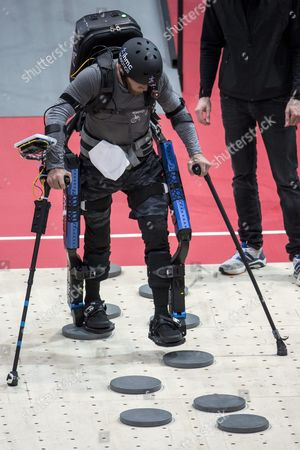 Stock Image of American Mark Clayton Daniel of Team Ihmc Competes at the Powered Exoskeleton Race During the First Cybathlon in Zurich Switzerland 08 October 2016 the First Cybathlon a Platform For the Development of Novel Assistive Technologies That Are Useful For Daily Life is Organised by the Eth Zurich Individuals with Physical Disabilities Will Compete Side by Side in Six Demanding Disciplines Using the Latest Assistive Technologies Switzerland Schweiz Suisse Kloten