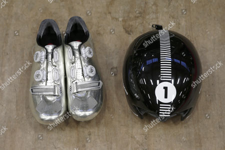 The Shoes and Helmet of German Cyclist Jens Voigt Seen Prior to His Attempt to Break the One Hour Cycling World Record at the Velodrome Suisse in Grenchen Switzerland 18 September 2014 Jens Voigt Will Attempt to Break the Classic Hour Record One of Cycling's Oldest and Hardest Tests Switzerland Schweiz Suisse Bern